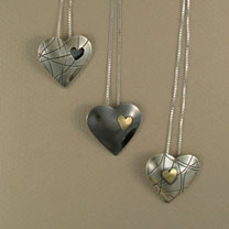 3 heart pendants